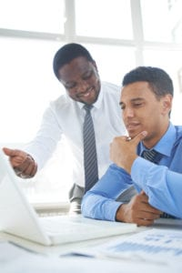 Finding a Mentor African-american businessman presenting his ideas to colleague at meeting