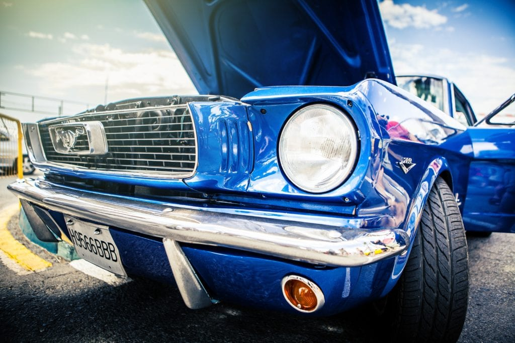 Classic blue Ford Mustang with opened hood.